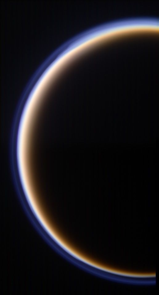 A portion of Titan and its atmosphere. Largest moon orbiting Saturn, bigger than mercury ;)