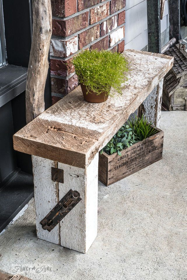 An easy to make chippy white barn wood bench, with random hardware for leg supports, perfect beside a front door. Decked out with an old plant filled crate and moss plant | funkyjunkinteriors.net