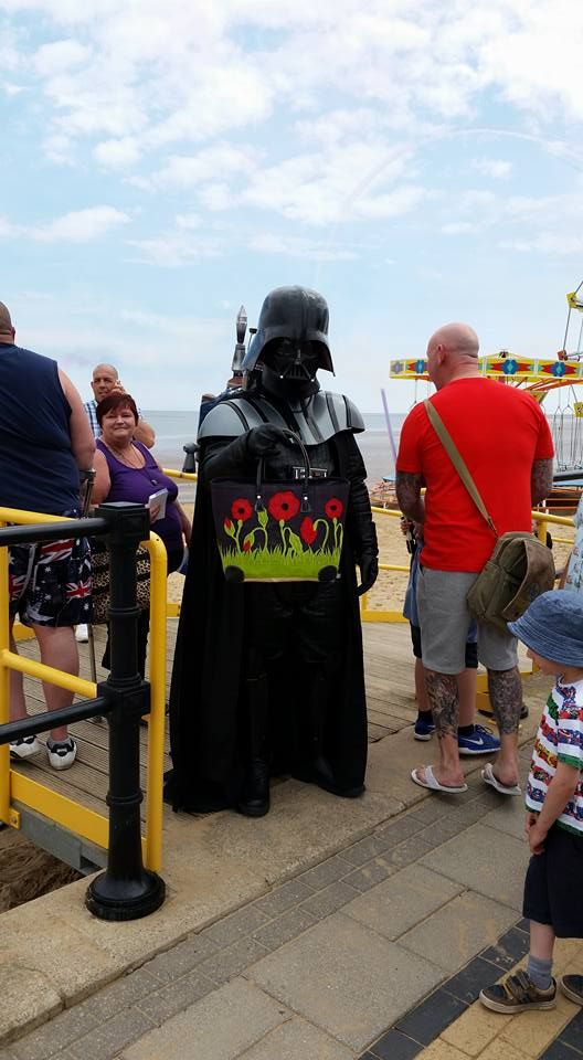 Darth chooses the dark side and our black poppy basket at Armed Forces Day in Cleethorpes.
