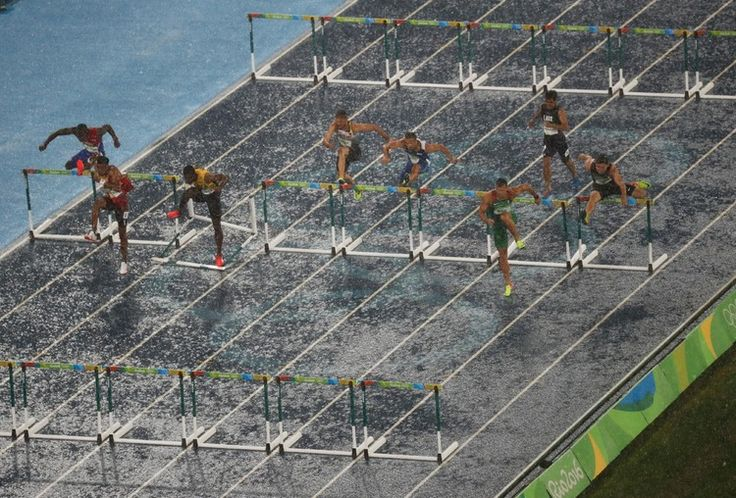 Torrential rain can't stop the men going in the 100m #hurdle heats, with the #athletes battling through in #rio2016 in phlow
