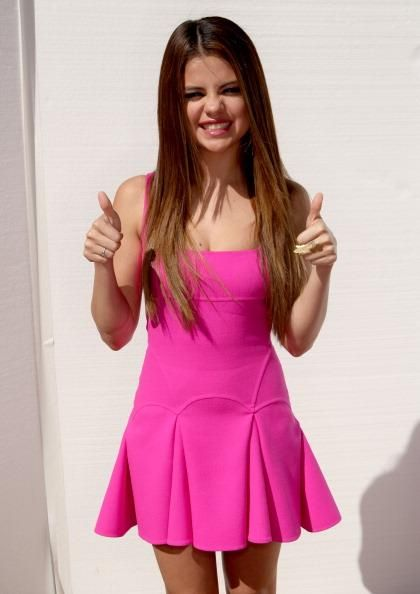 Selena Gomez in a cute pink dress looks like she's ready for summer♥♥♥