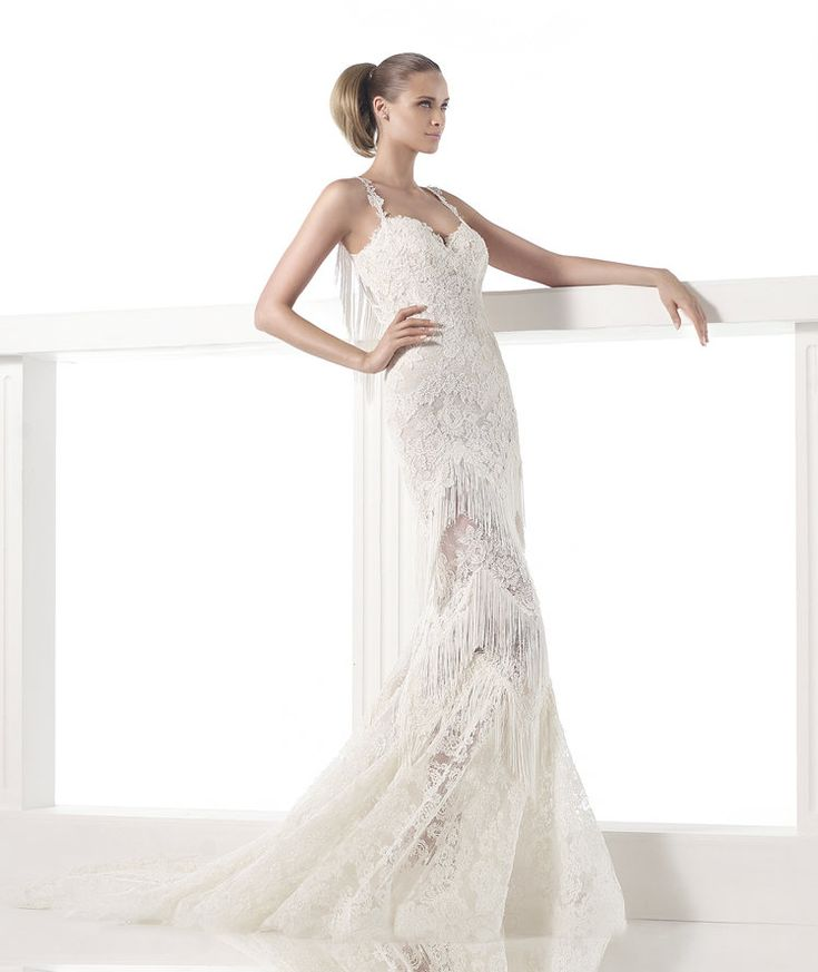 Popular  u Pronovias CARELI V neck wedding dress with lace and fringes Bodice with sweetheart neckline and lace straps Sheer skirt with lace and fringe
