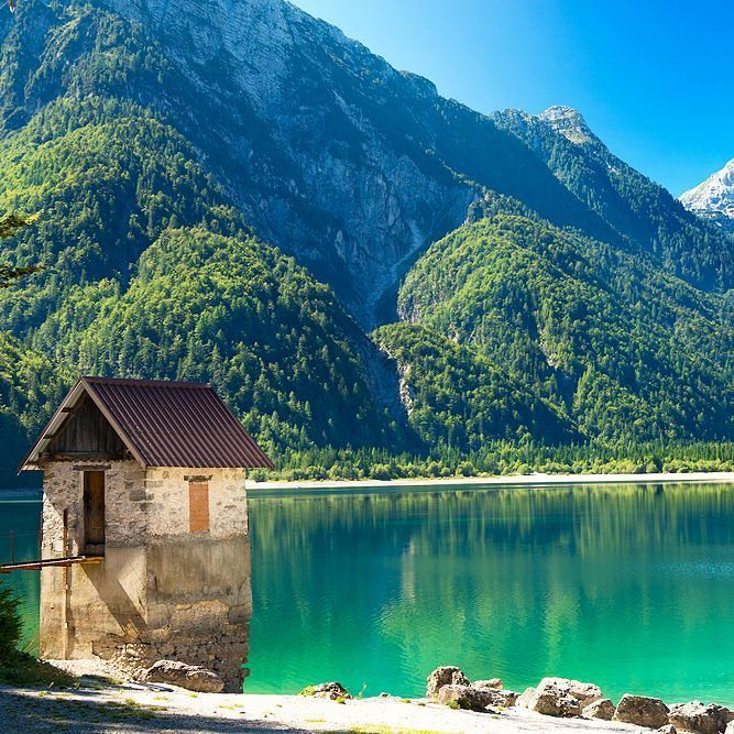 A bit too wet to live in perhaps but this adorable cottage stands at (or more correctly IN ) Lago del Predil.  It can be found in northern Italy near the Slovenian border. . . . . . #travelinspiration #lagodelpredil #lakepredil #italy #europe #italiannature #amazinglake #stonecottage #alpinelake #lakecottage #travelingram #explore #planetearth #discoveryourworld #travellink #travel