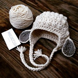 Sweet little hat. I will definitely make this again.  Yarn held double throughout. Used very very little of the fallen cloud.  I didn't do the ties as recommended in pattern, instead I folded...