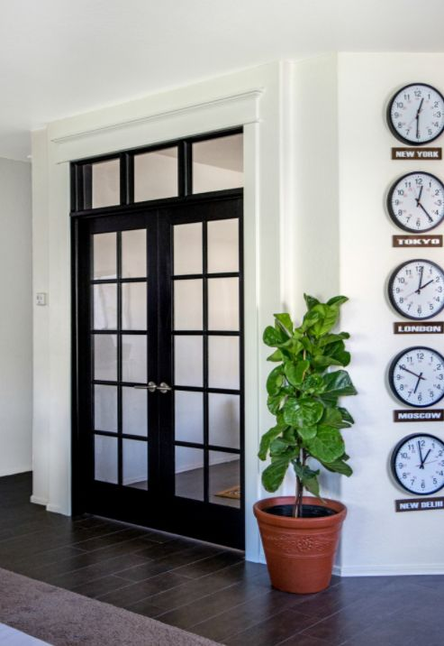 This DIY French doors tutorial from @homedepot lets you give your home the look and feel of an open layout, but without the hassle of tearing down any walls. Elisha painted her French doors a dark shade of BEHR Paint's Raven Black to create contrast with her bright white walls. Then, she built a custom transom window to draw even more light into her new den.