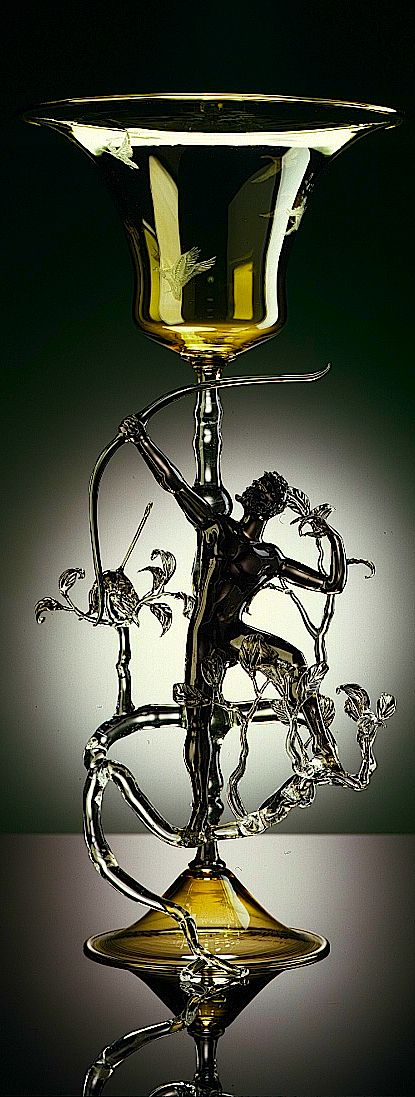 Lucio Bubacco - Lucio Bubacco is justly considered to be one of the greatest lampworkers of our time. His many talents include a natural feeling for nude sculpture and consummate craftsmanship in glass. Watching him pulling perfect sculptural form out of a blob of molten glass heated over a flame, as if it were second nature, is magic itself.