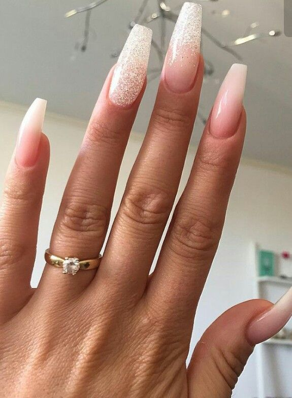 I like the simple gold band and diamond solitude. Her nails are good wedding nails too.