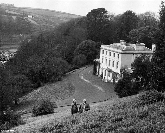 Agatha Christie seen walking with her second husband Sir Max Mallowan, the archaeologist, in the grounds of Greenway House in Devon