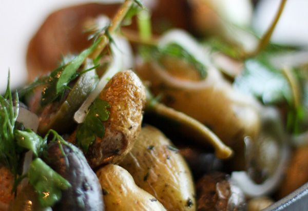 Yum, Roasted Marble Potatoes.  Baby potatoes, EVOO, garlic and thyme and a little bit of caper berries