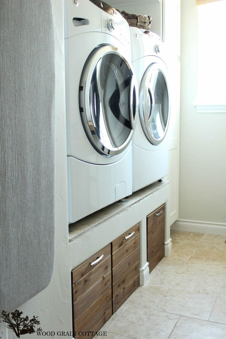 DIY Laundry Room Crates & Washer/Dryer on top of built out wall