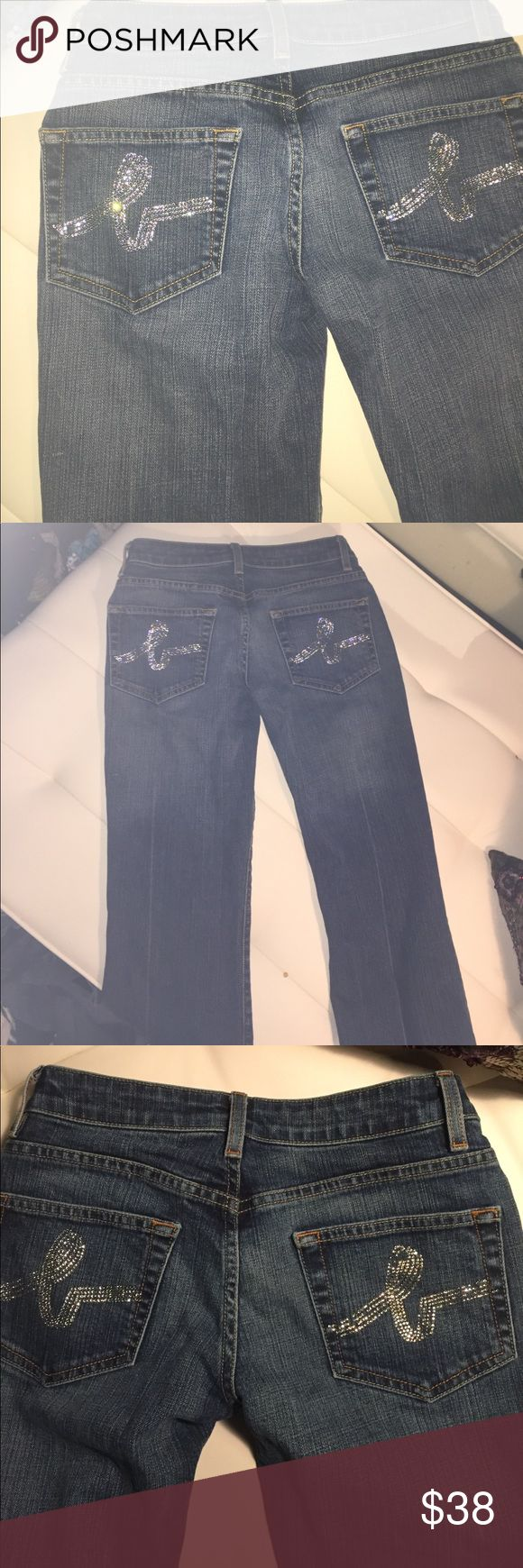 Bebe denim jeans with Rhinestone pockets dark wash These are soooo pretty on. Classy with a bit of jazz on the back pockets--nothing tacky. Look closely at photos a couple of rhinestones on right pocket fell off. No one should notice who shouldn't be noticing if you get what I mean;). Gorgeous dark wash. Great bargain!!! Sz 27 bebe Jeans Straight Leg