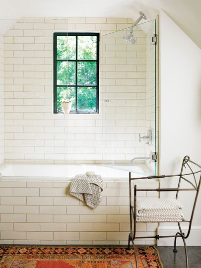 subway tile, polished concrete, glass, open shower, casement window, antique rug #bathroom