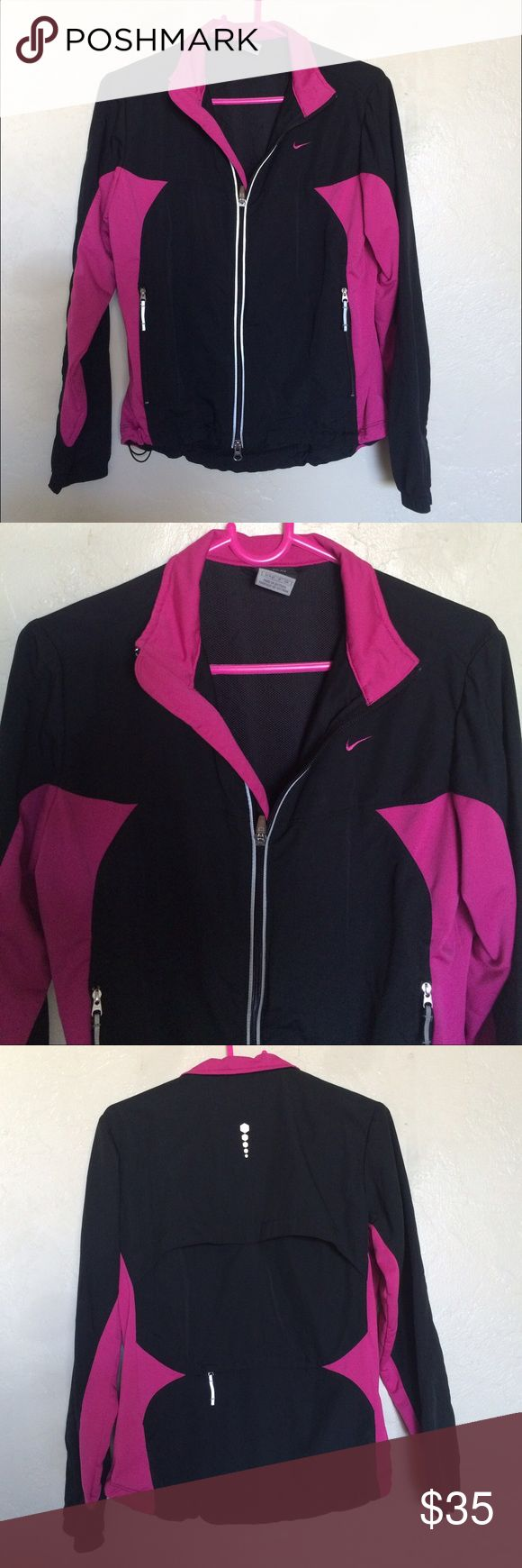 Nike Running jacket Black and pink. Has a lot of pockets. Excellent condition Nike Jackets & Coats