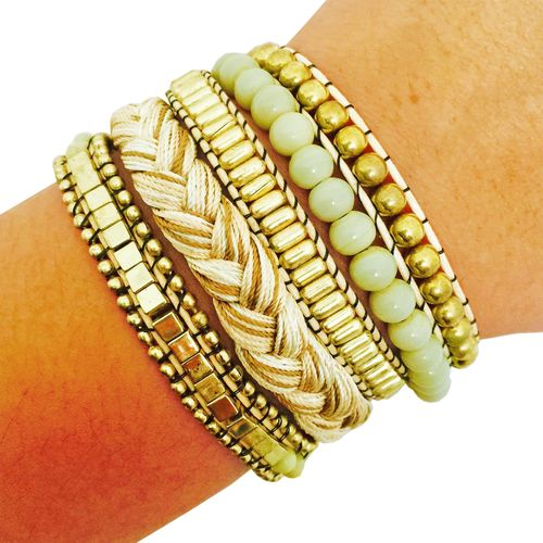 Shop the ROSIE Cream Ivory Beaded Stacked Snap Bracelet to stylishly hide your…