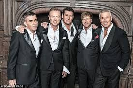 """Spandau Ballet are an English band formed in London in 1979. The band were inspired by, and an integral part of, the New Romantic movement. They became one of the most successful groups to emerge during the New Romantic era. The band's classic line-up features brothers Gary Kemp and Martin Kemp on guitars, vocalist Tony Hadley, saxophonist Steve Norman and drummer John Keeble.The group's debut single """"To Cut a Long Story Short"""", which reached No. 5 in the UK in 1980, was the first of ten UK…"""