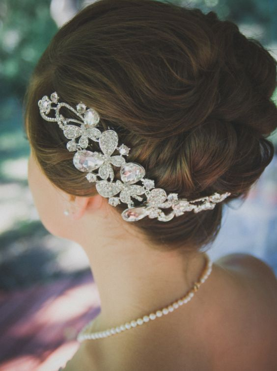 Glamorous updo wedding hairstyle with unique diamond hairpiece; Featured Photographer: From Britt's Eye View Photography