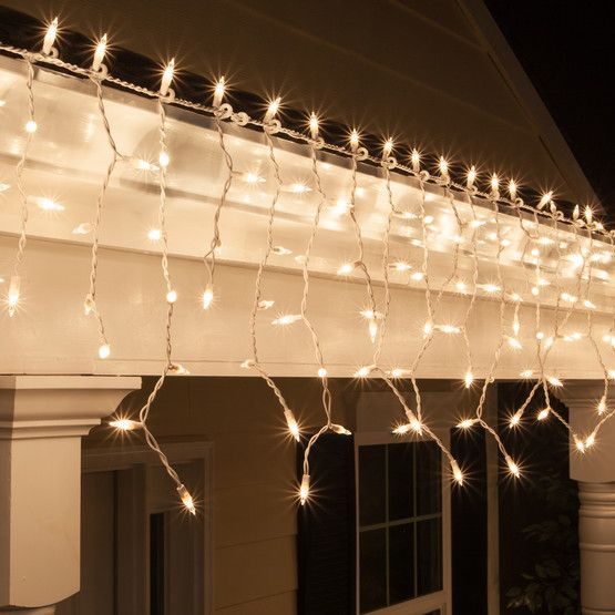 Classic white icicle lights on white wire. Love this elegant lighting at weddings!