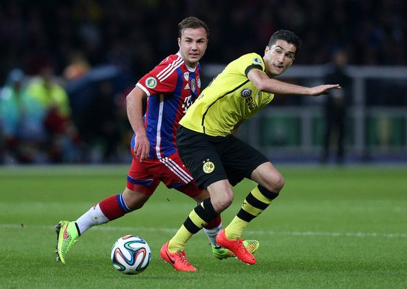 Nuri Sahin (R) of Borussia Dortmund and Mario Goetze of Bayern Muenchen vie for the ball during the DFB Cup Final match 2014 between Borussia Dortmund and Bayern Muenchen at Olympiastadion on May 17, 2014 in Berlin, Germany.