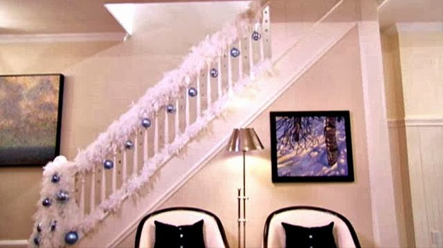 Sarah Richardson's Ideas for Celebrating Christmas in the City - feather boas as a garland on the stairs.