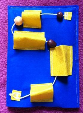 Bead maze - a tiny bit of sewing involved. Nice quiet activity to practice fine motor skills and coordination