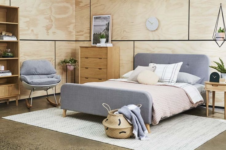 A cozy bedroom with natural timber storage and some light grey fabric accent, add some baskets and artwork for a stylish look!
