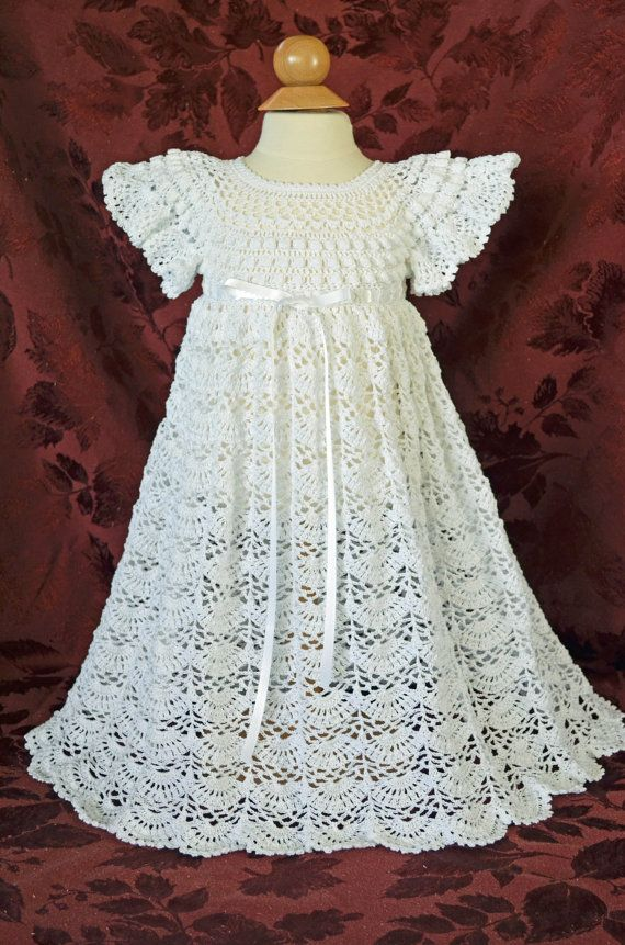 This unique Christening/Blessing dress is crocheted with #10 white cotton thread & accented with white ribbon around the waist. The detail of