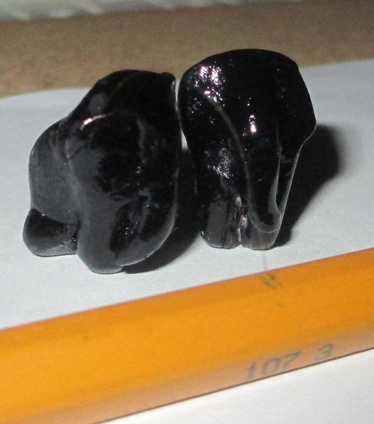 221B Baker Street - two black elephants