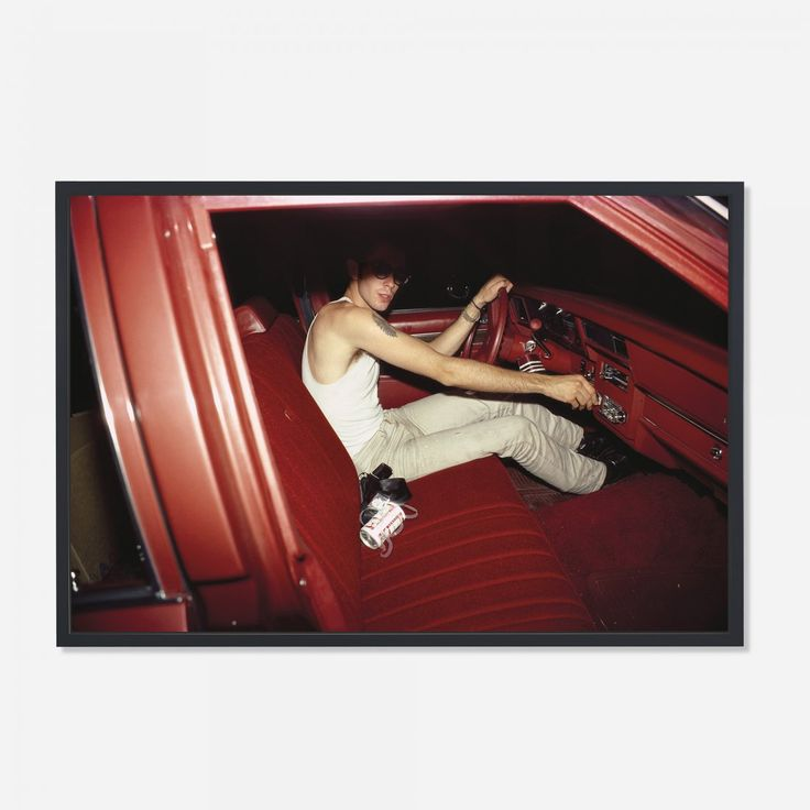Nan Goldin Mark in the red car, Lexington, MA