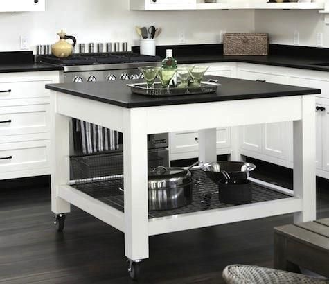 The island on casters can be easily repositioned; the shelf beneath is made of hog wire.