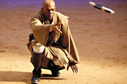 Attack of the Clones image attack April 18, 2003 - Catch Me If You Can - Using the Force, Mace Windu (Samuel L. Jackson) calls his lightsaber back to him.