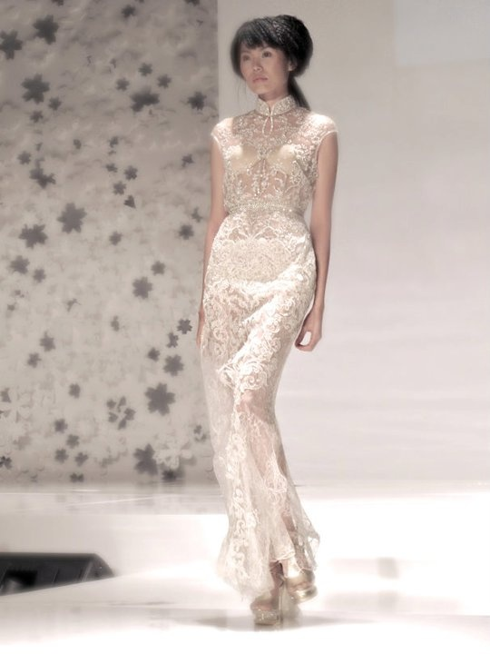 Runway Images : Sapto Djojokartiko Bride 2011 | High collared cap sleeved sheath wedding dress.