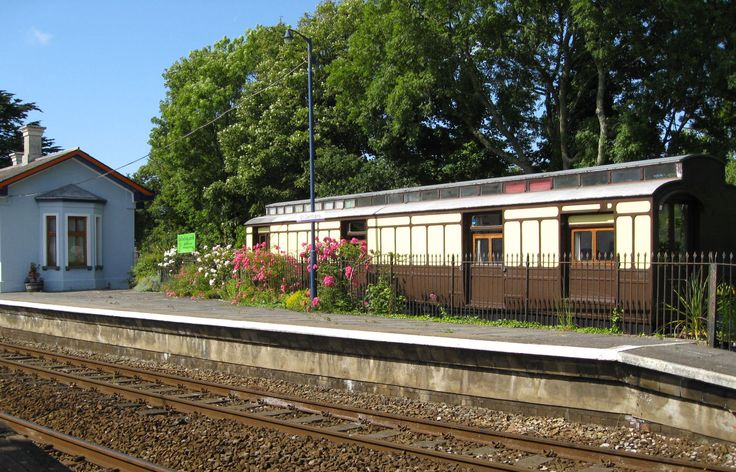 The holiday coach The Travelling Post Office sits in an enclosed garden beside the platform at St Germans station on the Cornish main line. The station house is lived in by the Strouds who run Railholiday, a collection of holiday railway carriages in Cornwall. It's a great place to train-spot, but there are usually no trains during the night.