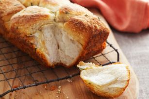 """Parmesan-Herb Biscuit Bread recipe - Serve this buttery-tasting bread to cement your status as """"awesome."""" They'll never know it took a mere 15 minutes to put together."""