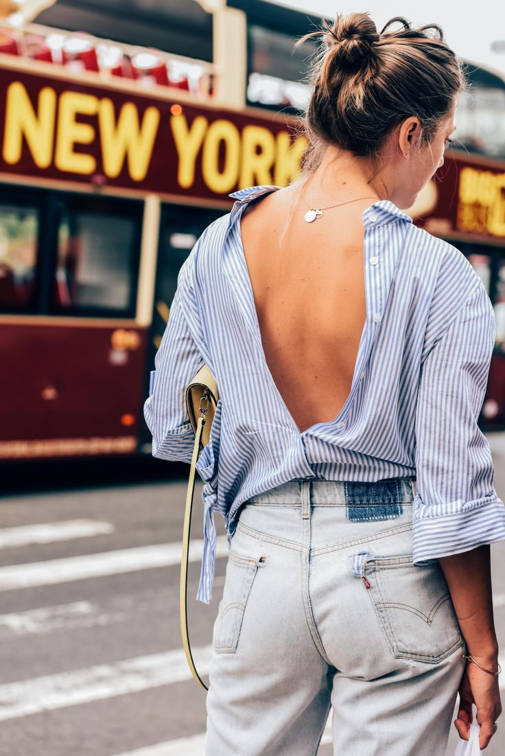 Try wearing a button-down shirt backwards for a new take on a classic