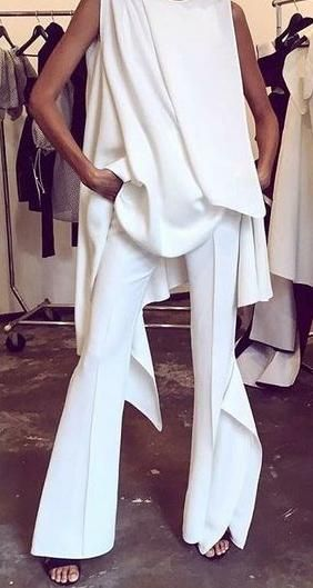 all white. flare trousers.