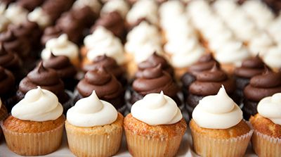 Closeup of wedding cupcakes in monogram setting