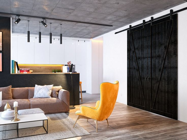 Fun combination of concrete ceilings, wood floors and Mid-Century Modern furniture
