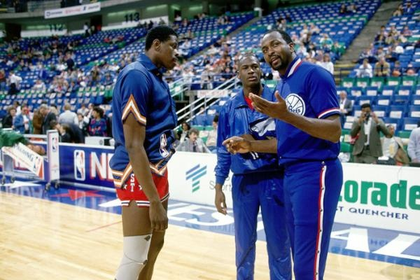 Patrick Ewing, Moses Malone and Michael Jordan chat before the 1986 All-Star game