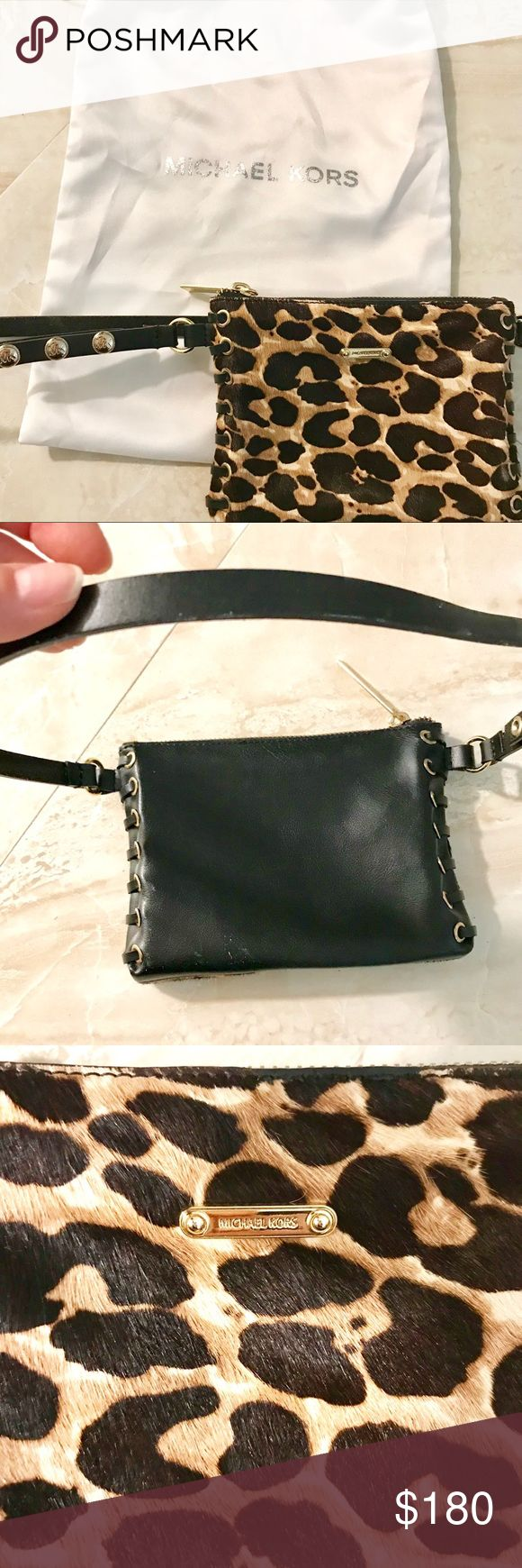 Authentic Michael Kors leather clutch /belt New ! Gorgeous Black leather ( back side ) with leopard hair (front) reversible belt with woven sides and Gold embellishments.   Size Small to Medium. 24 in waits to 36 in. Adjustable leather belt.    New wot. Come as with original dust bag.  Retail 390$ Michael Kors Bags Clutches & Wristlets