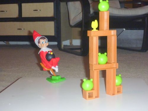 Elf on the Shelf plays Angry Birds.