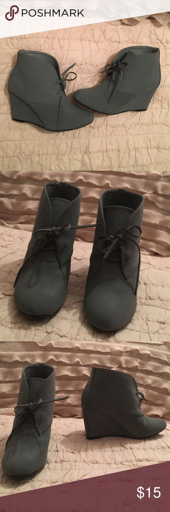 Gray wedge ankle booties These beautiful pair of gray wedge booties have never been worn! I love them but they're just a bit too small for me. Mark & Maddux Shoes Ankle Boots & Booties