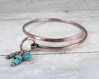 ♦ Copper Bangles With Aqua Crystals and Glass Beads, Set of Two, 2 Hammered Copper Wire Wrapped Bangle Bracelets, Stacking Bangles Cold Forged and antiqued with medium patina. This listing is for the (2) rustic copper bangles shown. They are made from 8 gauge recycled copper wire that has been hammered, Antiqued and hand polished. Beads are wire wrapped with 18 gauge wire. The Healing Properties of Copper: Some wearers of copper jewelry find it relieves the symptoms of arthritis and…