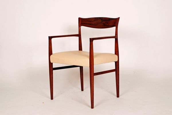 Knud Ferch armchair in rosewood. Seat padded in light cognac leather