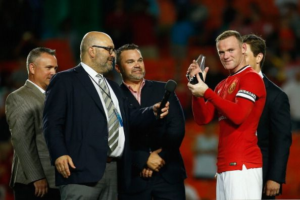 Wayne Rooney #10 of Manchester United holds the man of the match award following his team's victory over Liverpool in the Guinness International Champions Cup 2014 Final at Sun Life Stadium on August 4, 2014 in Miami Gardens, Florida. United defeated Liverpool 3-1