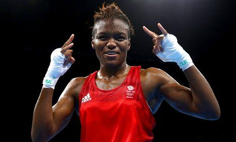 Nicola Adams celebrates becoming the first British boxer to retain an Olympic title in 92 years at Rio Centro on Saturday. 20.08.2016