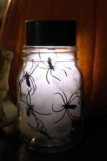 Jar of spiders... a glow stick in a jar surrounded by cotton, and plastic spiders.