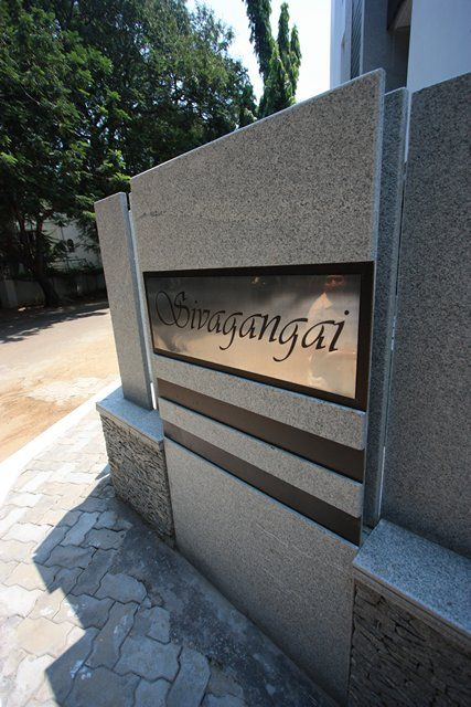 Name plate designed in stone and metal finish. Name