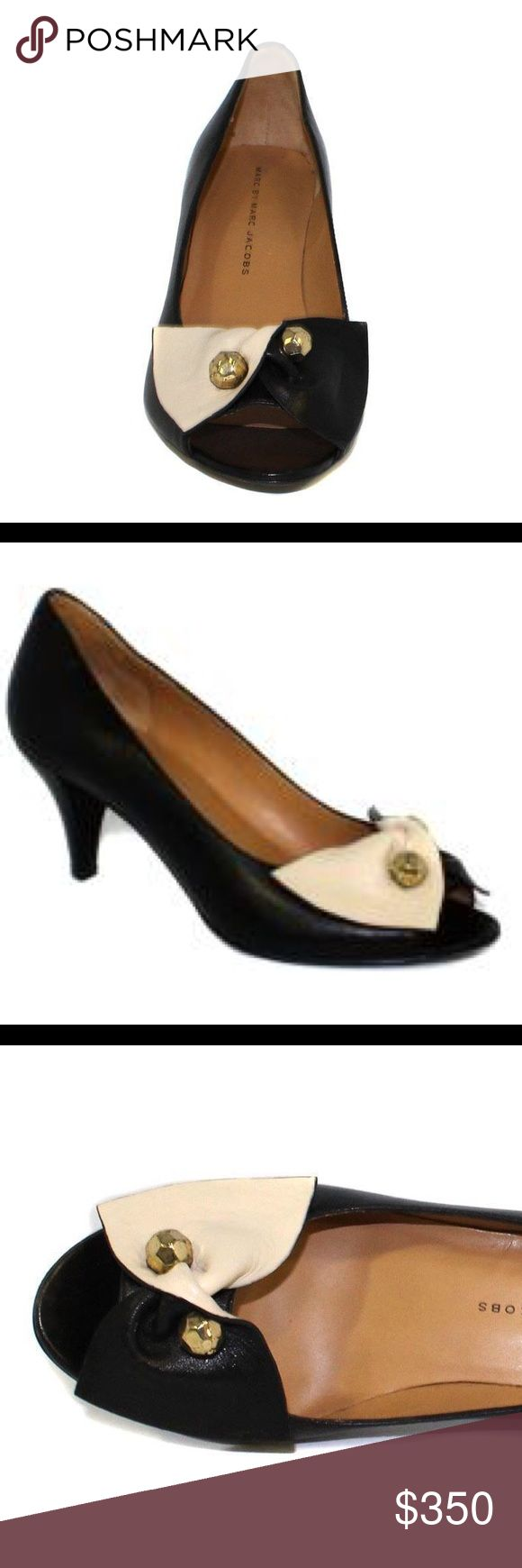 ISO Marc Jacobs 605641 Milk Black and Gold Pump ISO Marc Jacobs 605641 Milk Black and Gold Pump. My favorite heels, looking for a new(er) pair. Marc Jacobs Shoes Heels