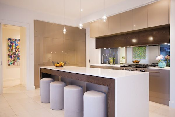 Warm tones, timber highlights and discreet lighting give this kitchen an inviting feel.