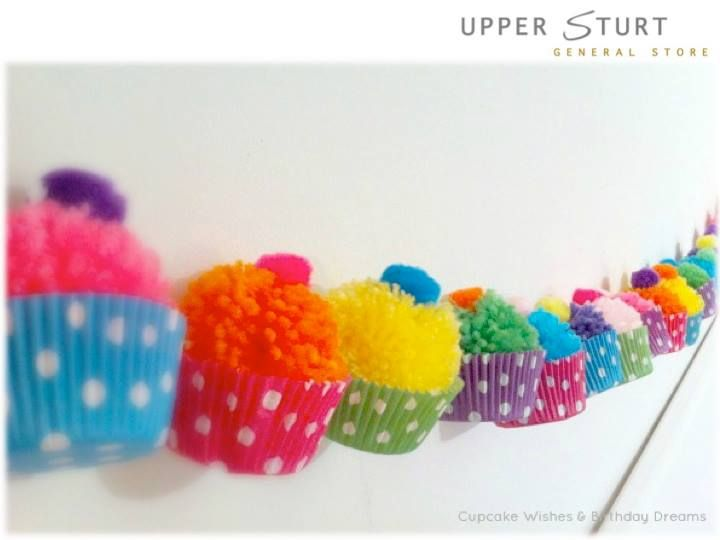 Cup Cake Pom-Pom Garland! Would be perfect for a birthday party, or just as lovely decoration.